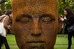 """© Licensed to London News Pictures. 01/10/2020. LONDON, UK. Women view """"Meditation 1554"""", 2019, by contemporary Korean artist Seo Young-Deok, on display in Grosvenor Square as part of the inaugural Mayfair Sculpture Trail which will be on show for the month of October.  The sculpture trail forms part of the seventh, annual edition of Mayfair Art Weekend which celebrates the rich cultural heritage of Mayfair as one of the most internationally known, thriving art hubs in the world with free exhibitions, tours, talks and site-specific installations available to the public.  Photo credit: Stephen Chung/LNP"""