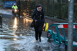 © Licensed to London News Pictures. 22/11/2016. Rotherham, UK. A woman wades through water on a flooded road in Rotherham, South Yorkshire, after a river broke it's banks last night. Storm Angus has brought heavy wind and rain to much of the UK this week with flooding seen all over. Photo credit : Ian Hinchliffe/LNP