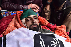 April 25, 2018 - Pulwama, Jammu & Kashmir, India - Dead body of Ishfaq Ahmed during his Funeral procession at his residence Handura Village of Tral in south Kashmir's Pulwama District. Ishfaq Ahmed was a local militant who got killed along with his 3 Associates in a 12 hour Long Gunfight In Lam Forests Of Tral On Tuesday 26 April 2018. Reportedly Thousands of peoples including men, women, childrens attended the funeral procession of Ishfaq Ahmed on Wednesday in Tral Some 50 kms away from Srinagar summer capital of Indian Kashmir. Two security forces were also killed and two army men wounded in the gunfight. (Credit Image: © Abbas Idrees/SOPA Images via ZUMA Wire)