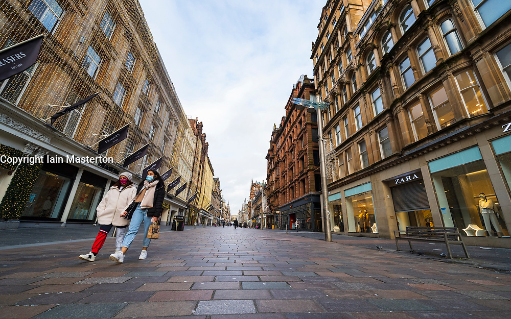 Glasgow, Scotland, UK. 25 November 2020. Glasgow city centre  very quiet during severe level 4 lockdown imposed by the Scottish Government.  Non essential businesses , bars, restaurants and shops are closed. Pictured; Buchanan Street is almost deserted. Credit.  Iain Masterton