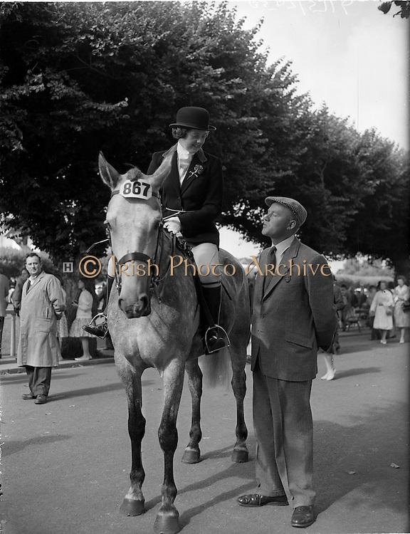 03/08/1960<br /> 08/03/1960<br /> 03 August 1960<br /> R.D.S Horse Show Dublin (Wednesday). Mr. Samuel R. Martin has a word with Mrs Roy Irvine, Lisburn at the Dublin Horse Show.
