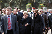 Moscow, Russia, 26/04/2007..Boris Yeltsin's widow Naina and daughters Yelena [black scarf] and Tatyana [dark glasses] make a private visit to to his grave the morning after the former Russian President was buried. Security guards escort the family away from the grave..