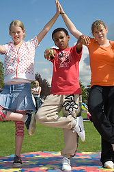 Teenagers doing street dance moves during a dance workshop at a Parklife summer activities event,