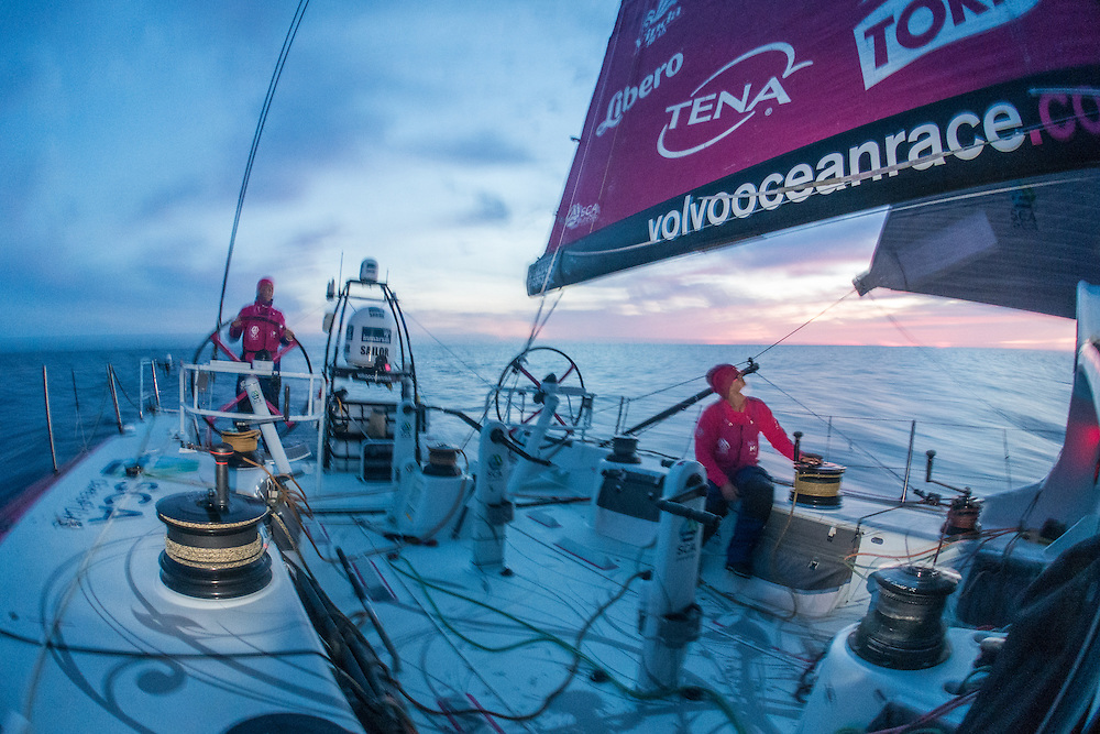 May 5, 2015. Leg 6 to Newport onboard Team SCA. Day 16. Sam Davies helms and Sally Barkow trims during the sunset.