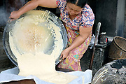 An Intha woman  making tofu on 22nd January 2016 in Shan State, Myanmar. Located on the northwestern shore of Inle Lake, the Intha village of Kaung Daing is known for its tofu, prepared using split yellow peas instead of  soybeans