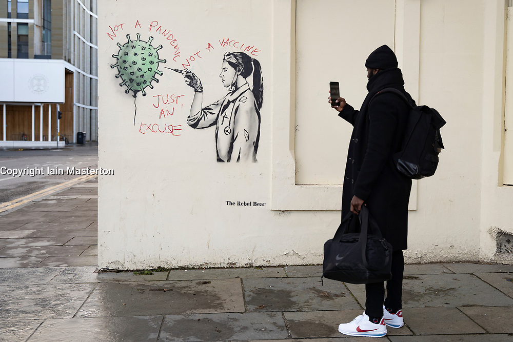 Edinburgh, Scotland, UK. 15 December 2020. Street art of Covid-19 vaccination by street artist  The Rebel Bear in Edinburgh is vandalised by anti vaccination protestor. Iain Masterton/Alamy Live News