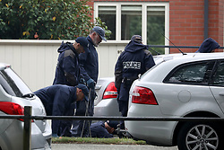 March 18, 2019 - Christchurch, New Zealand - Police officers search for evidence outside the Al Noor mosque in Christchurch, New Zealand on March 17, 2019. At least 50 people were killed and 36 injured in mass shootings at two mosques in the New Zealand city of Christchurch Friday, 15 March. A 28-year-old Australian born man appeared in Christchurch District Court on Saturday charged with murder. (Credit Image: © Sanka Vidanagama/NurPhoto via ZUMA Press)