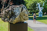 Emily Young, Planet(2012) and Ugo Rondinone, Summer Moon (2011) - The Frieze Sculpture Park 2017 comprises large-scale works, set in the English Gardens . The installations will remain on view until 8 Oct 2017.