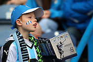 a young Huddersfield Town fan looks on as he waits to collect autographs. Skybet football league Championship match, Huddersfield Town v Sheffield Wednesday at the John Smith's Stadium in Huddersfield, Yorkshire on Saturday 2nd April 2016.<br /> pic by Chris Stading, Andrew Orchard sports photography.