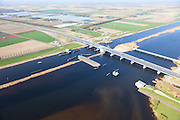 Nederland, Flevoland-Overijssel, Ramspol, 01-05-2013; nieuwe Ramspolbrug in de N50 met achter de brug de balgstuw. De vaargeul in het Ramsdiep met strekdam.<br /> Boven in beeld kassen met glastuinbouw.<br /> Ramspol, inflatable dike, between Ketelmeer and Black Water. The Balgstuw (bellow barrier) is a storm barrier and consists of an inflatable dam or dyke, composed of three bellows. Usually, each bellow rests on the bottom of the water, but now the bellows are inflated  because of maintenance.luchtfoto (toeslag op standard tarieven)<br /> aerial photo (additional fee required)<br /> copyright foto/photo Siebe Swart