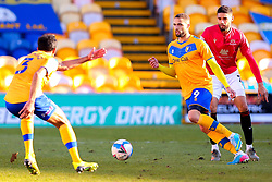 Jordan Bowery of Mansfield Town under pressure from Kelvin Mellor of Morecambe passes the ball to Malvind Benning of Mansfield Town - Mandatory by-line: Ryan Crockett/JMP - 27/02/2021 - FOOTBALL - One Call Stadium - Mansfield, England - Mansfield Town v Morecambe - Sky Bet League Two