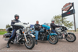 Flanked by two South Dakota Highway Patrol, Jim Entenman of J and L Harley-Davidson sits on a 2018 Harley-Davidson Street Glide donated and painted to commemorate the christening of the USS South Dakota submarine. Sioux Falls, SD. USA. Monday October 9, 2017. Photography ©2017 Michael Lichter.