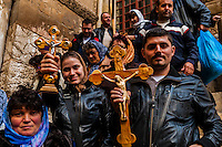 Armenian pilgrims outside the Church of the Holy Sepulchre (site of the last five stations of the Cross and venerated as the place where Jesus was crucified and buried), the Christian Quarter, Old City, Jerusalem, Israel.