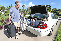 """Joe Roth, 53, of Cocoa Beach, FL, USA, packs his family's car on Wednesday, Oct. 5, 2016 as he and his wife Debi prepare to evacuate as Hurricane Matthew approaches Florida. """"I know when they tell you to get out, you go,"""" Roth said. Photo by Red Huber/ Orlando Sentinel/TNS/ABACAPRESS.COM"""