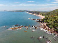 Aerial view of vacant Querim beach on a bright cloudy day in North Goa, India.