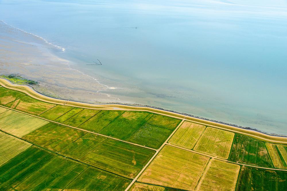 Nederland, Friesland, Terschelling, 05-08-2014;  Terschellingerpolder ten zuiden van Oosterend. Zicht op het Wad en de Waddenzee.<br /> Wadden island Terschelling with polders and Wadden Sea.<br /> luchtfoto (toeslag op standard tarieven);<br /> aerial photo (additional fee required);<br /> copyright foto/photo Siebe Swart