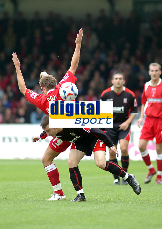 Photo: Kevin Poolman.<br />Swindon Town v Lincoln City. Coca Cola League 2. 28/10/2006. Swindon's Michael Pook comes down on top of Lincoln's Lee Frecklington.