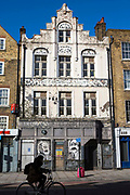 A derelict old traditional pub previously owed by Truman's brewery and called The Crown and Shuttle in Bishopsgate, central London, United Kingdom.  The building has been secured with barricades to prevent trespassing, but has been decorated with graffiti art. The pub has since been renovated and is now open again.