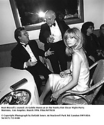 Kurt Russell ( seated ) & Goldie Hawn at at the Vanity Fair Oscar Night Party Mortons,  Los Angeles. March 1994. Film.94578/24<br /><br />© Copyright Photograph by Dafydd Jones<br />66 Stockwell Park Rd. London SW9 0DA<br />Tel 0171 733 0108