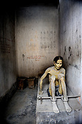 Dramatic reconstruction of a prisoner in a war-time prison cell. War Remnants Museum, Ho Chi Minh City (Saigon), Vietnam