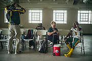 """BIRMINGHAM, AL – SEPTEMBER 11, 2015: Sonya Whitaker (center) helps Quintarius Monroe (right) check his blood sugar before a football game. """"I'm here to make sure he doesn't get in trouble,"""" Whitaker said. Whitaker works part time as a LPN to oversee Monroe's care, attending every football practice and game. """"The potential problem is his sugar will drop, being active. I check his blood sugar before and after practice."""" A type 1 diabetic, Monroe requires frequent blood sugar testing and supervision when self-administering insulin. When care from qualified personnel at his school in Center Point became unavailable, Monroe was forced to transfer several miles away from his locally zoned school to attend Woodlawn High School. The Americans with Disabilities Act requires schools to provide """"reasonable accommodation"""" for students with medical conditions, but given that most schools no longer retain school nurses, many schools are failing to provide adequate care for their students.<br /> CREDIT: Bob Miller for The New York Times"""