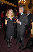 Basia Briggs and Richard Kay, Reception to support the Hyde Park Appeal for Liberty Drives ( a charity which enables people to travel around Hyde Park in electric buggies) in the presence of Prince Michael of Kent. Officers Mess. Household Cavalry Mounted Regiment. Hyde Park Barracks. 30 November 2004. ONE TIME USE ONLY - DO NOT ARCHIVE  © Copyright Photograph by Dafydd Jones 66 Stockwell Park Rd. London SW9 0DA Tel 020 7733 0108 www.dafjones.com
