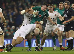 Ireland's James Ryan tackled by England's Billy Vunipola, Tom Curry and Ellis Genge during the Guinness Six Nations match at the Aviva Stadium, Dublin.