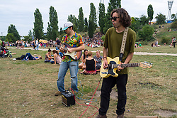 Musicians playing at weekend at Mauerpark in Prenzlauer Berg in Berlin Germany