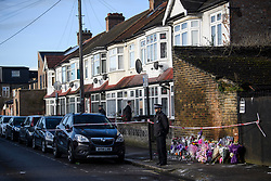 © Licensed to London News Pictures. 04/04/2018. London, UK. Police officers stand next to floral tributes left on Chalgrove Road, Tottenham, north London, the scene where 17 year old Tanesha Melbourne, was shot dead on Monday. A recent spree of killings in the capital has taken the murder toll for the year so far to 48. Photo credit: Ben Cawthra/LNP