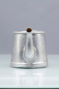 silver colored small one person coffee pot