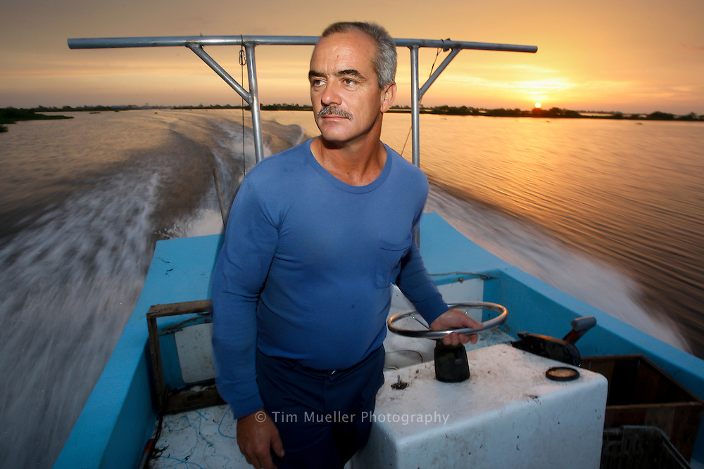 Nicholas Alfonso pulls crab traps near Delacroix Island, Louisiana. A shrimper for 25-years, Alfonso started crabbing this year to supplement his income.