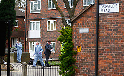 © Licensed to London News Pictures. London, UK. 31/03/2014. Forensics at the scene where Police officers investigate the murder of a mother and her daughter at their home in Oswald Mead, Homerton. They found a 45-year old woman, a 23-month old baby girl and a 53-year old man suffering from injuries this morning (31/03/14). The man was taken to a hospital in east London and has been arrested on suspicion of murder. Photo credit: LNP