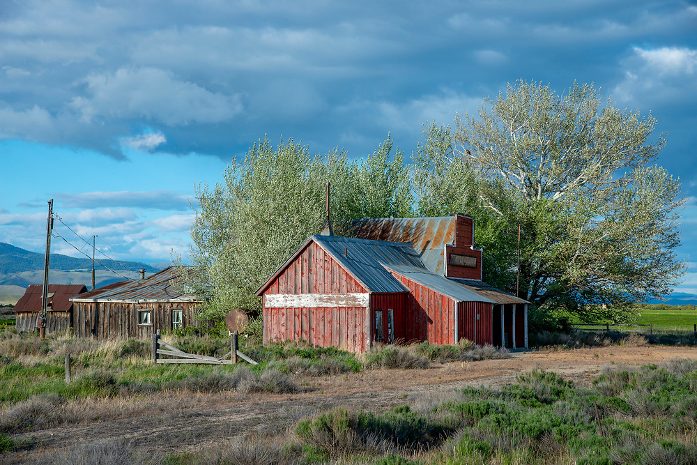 Licensing - Open Edition Prints<br /> Corral Store long closed and abandoned greets a welcome spring on the Camas Prairie in Southwest Idaho