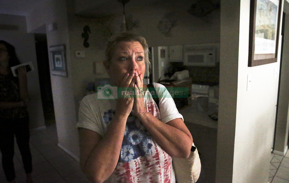 August 30, 2017 - Rockport, Texas, U.S. - Fears of a destroyed interior are vanquished as ROBYN HARRELSON is stunned to see the interior of her condo as recovery proceeds in Rockport. Hurricane Harvey, which landed as a Category 4, hit directly into the coastal Texas city of Rockport. (Credit Image: © Tom Reel/San Antonio Express-News via ZUMA Wire)