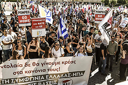 Communist-affiliated protesters hold placards as they take part in a demonstration to protest against the visit of US Secretary of State Mike Pompeo in Athens on October 5, 2019.<br /> <br /> Pictured: <br /> Dimitris Lampropoulos  | EEm date