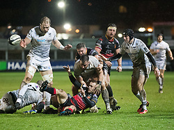 Dragons' Sarel Pretorius gets the ball away despite pressure from Ospreys' Scott Baldwin<br /> <br /> Photographer Simon King/Replay Images<br /> <br /> Guinness Pro14 Round 12 - Dragons v Cardiff Blues - Sunday 31st December 2017 - Rodney Parade - Newport<br /> <br /> World Copyright © 2017 Replay Images. All rights reserved. info@replayimages.co.uk - http://replayimages.co.uk