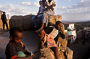 Children playing on the walls of the ancient city of Harar. Situated in Eastern Ethiopia it is considered to be the fourth  holiest city in Islam with 82 mosques. It is a major commercial centre linked by trade routes with the rest of Ethiopia and the entire Horn of Africa.  Ethiopia