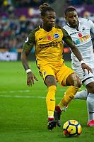 Football - 2017 / 2018 Premier League - Swansea City vs. Brighton & Hove Albion<br /> <br /> Gaëtan Bong of Brighton and Hove Albion challenged by Kyle Naughton of Swansea City, at The Liberty Stadium.<br /> <br /> COLORSPORT/WINSTON BYNORTH