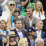 Anna Wintour and David Beckham  watching Novak Djokovic, Serbia, winning the Men's Singles Final against Roger Federer, Switzerland, during the US Open Tennis Tournament, Flushing, New York, USA. 13th September 2015. Photo Tim Clayton
