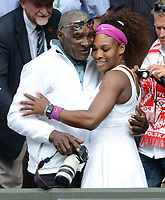 Wimbledon Week 2 : Tennis Championships 2012<br /> Ladies singles final. Credit : Andrew Cowie / Colorsport. 07/07/2012 <br /> Serena Williams v Agnieszka Radwanska.<br /> Serena Williams - USA climbs up into the players box to greet her father