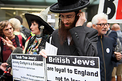 © Licensed to London News Pictures. 04/09/2018. London, UK. A member of the group Labour Against The Witch-hunt, dressed as a witch, stands next to a member of the Jewish Community, outside Labour Party headquarters in London ahead of a National Executive Committee meeting. The Labour Party's ruling body is expected to vote on whether to adopt, in full, the IHRA (International Holocaust Remembrance Alliance) definition of anti-Semitism. Photo credit: Ben Cawthra/LNP
