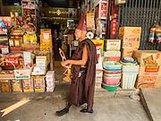 07 MARCH 2014 - MAE SOT, TAK, THAILAND:  A Burmese Buddhist hermit monk walks through Mae Sot, on the Thai side of Thai-Myanmar border.    PHOTO BY JACK KURTZ
