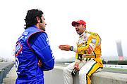 30 March - 1 April, 2012, Birmingham, Alabama USA.Tony Kanaan and Dario Franchitti chat before first practice. .(c)2012, Jamey Price.LAT Photo USA