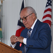 CANASTOTA, NY - JUNE 14: Boxing promoter Rafael Mendoza puts on his ring as he speaks during the induction ceremony at the International Boxing Hall of Fame induction Weekend of Champions events on June 14, 2015 in Canastota, New York. (Photo by Alex Menendez/Getty Images) *** Local Caption *** Rafael Mendoza