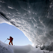 Glaciologist Andrea Fischer of the Austrian Institute for Interdisciplinary Mountain Research, walks at the entrance of an ice cave of Jamtalferner glacier near Galtuer, Austria, February 18, 2019. REUTERS/Lisi Niesner