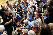 Residents evacuated from the Yarnell Hill fire listen to Incident Commander Clay Templin (L) at a community meeting in Prescott, Arizona July 2, 2013.   An elite squad of 19 Arizona firemen was  killed in the worst U.S. wildland firefighting tragedy in 80 years apparently outflanked and engulfed by wind-whipped flames in seconds, before some could scramble into cocoon-like personal shelters on June 30, 2013.  REUTERS/Rick Wilking (UNITED STATES)