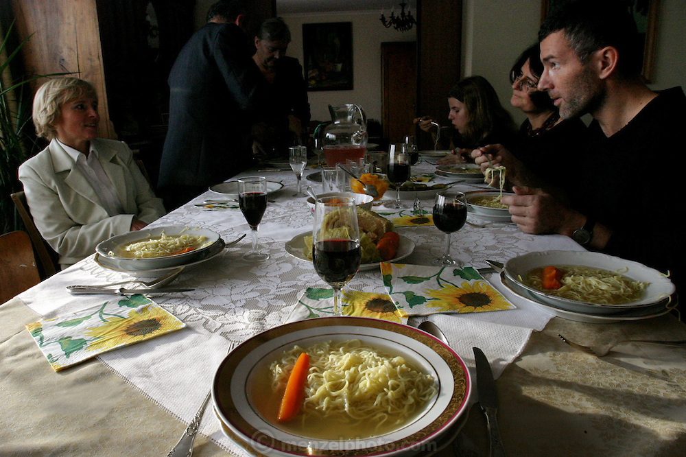 Family dinner in honor of All Saints Day in Poland. (Supporting image from the project Hungry Planet: What the World Eats.)