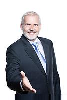 caucasian senior businessman portrait welcoming handshake isolated studio on white background