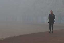 © Licensed to London News Pictures.  20/04/2021. Broadstairs, UK. A member of the public walks through the foggy dawn at Viking Bay in Broadstairs, east of Kent. As a mini heatwave is forecast to hit parts of UK this week with high temperatures reaching 22 celsius. Photo credit: Marcin Nowak/LNP