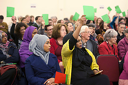 © Licensed to London News Pictures.  31/03/2015. Bristol, UK.  General Election 2015.  Women hold up green cards to show they agree with the point made by one of the candidates for the Bristol West constituency taking part in Bristol Women's Voice Women's Question Time at the Unitarian Chapel, Brunswick Square.  Bristol West was held by the Lib Dems at the last election with a majority of more than 11,000, but both Labour and the Green Party are targeting the seat for a win.  Photo credit : Simon Chapman/LNP